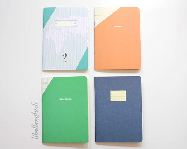 Compat paperways vier Hefte nebeneinander